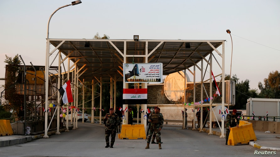 FILE - Iraqi security forces gather at a checkpoint into the Green Zone in Baghdad, Dec. 10, 2018.