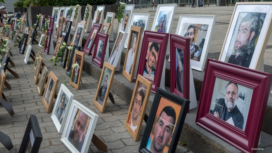 Portraits of Syrian detainees are seen at Koblenz court in Germany where trials started last June of two people alleged to be former Syrian intelligence officials involved in crimes against humanity inside Syrian prisons.  (Courtesy: Maimouna al-Ammar)