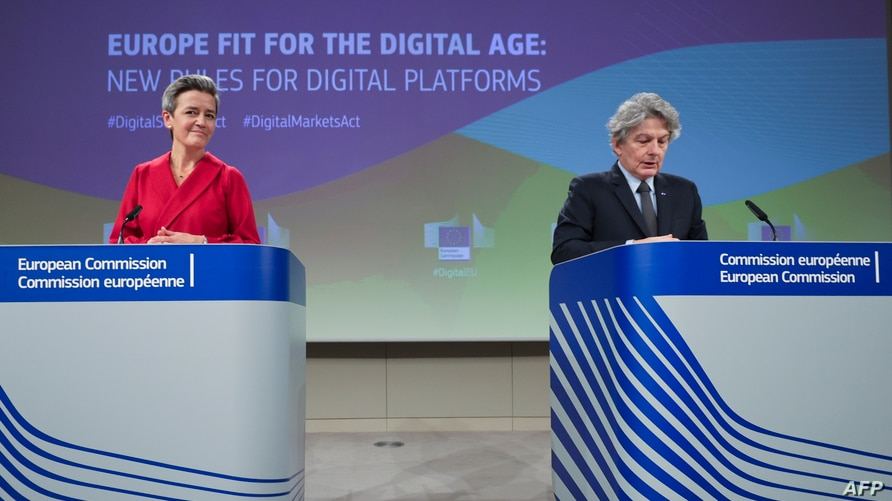 Executive Vice President of the European Commission for A Europe Fit for the Digital Age Margrethe Vestager (L), and European…