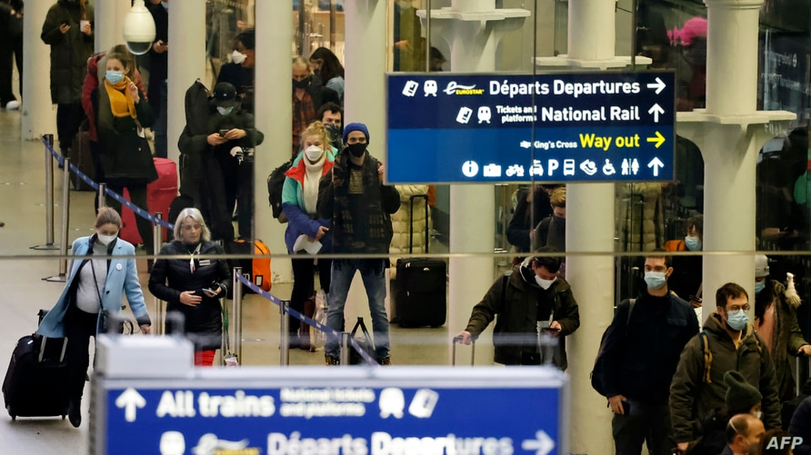 Passengers arrive at the Eurostar International Departures hall at St Pancras International station in London on December 23,…