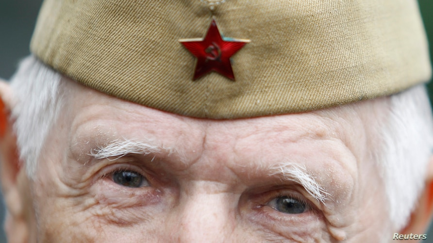 A World War II veteran looks on during a Victory Day celebration in Gorky Park in Moscow May 9, 2012. Russia celebrated on…
