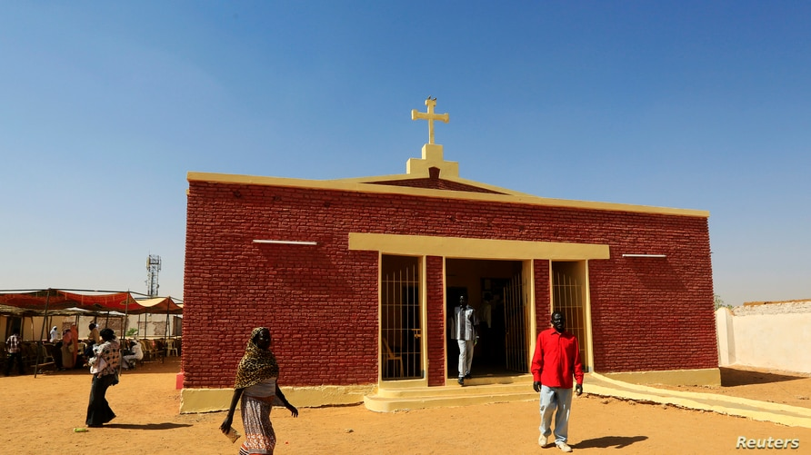 South Sudanese living in the North walks near a Catholic Church during Christmas day celebrations in the Umbada locality of…