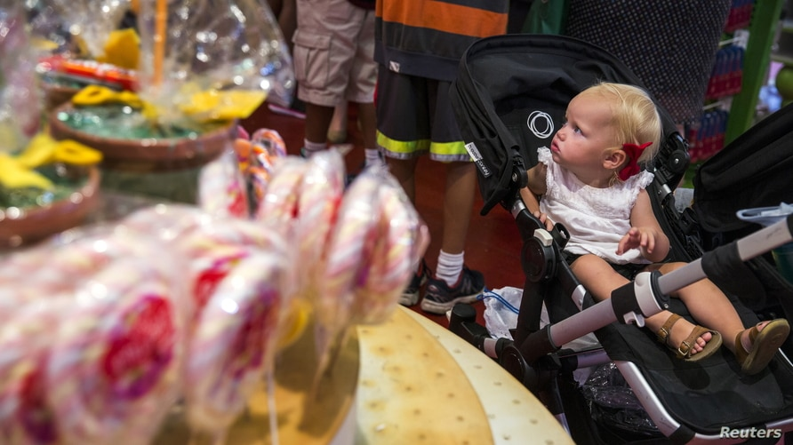 A young child looks at the array of candy displayed inside the toy store FAO Schwarz on the last day that the store will be…
