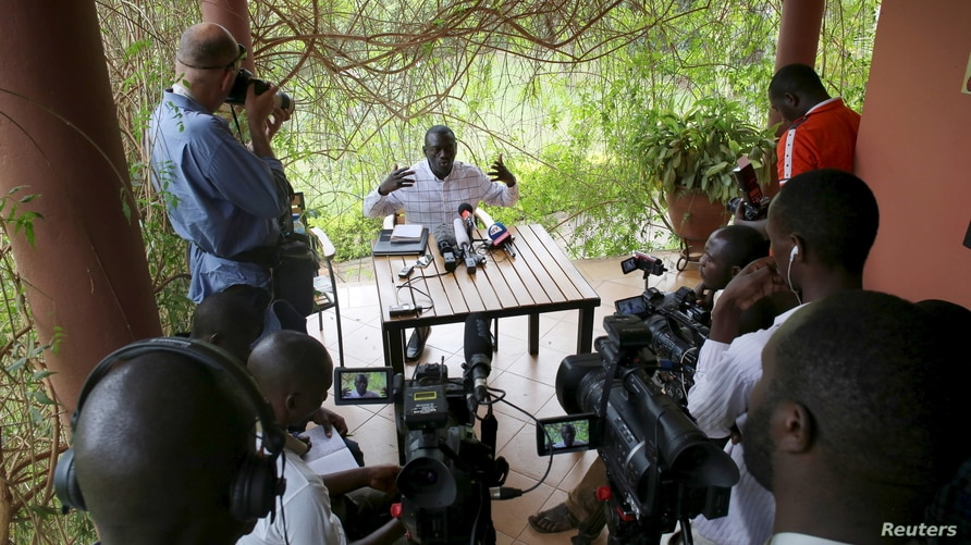 Opposition leader Kizza Besigye speaks during a news conference at his home at the outskirts of Kampala, Uganda, February 21,…