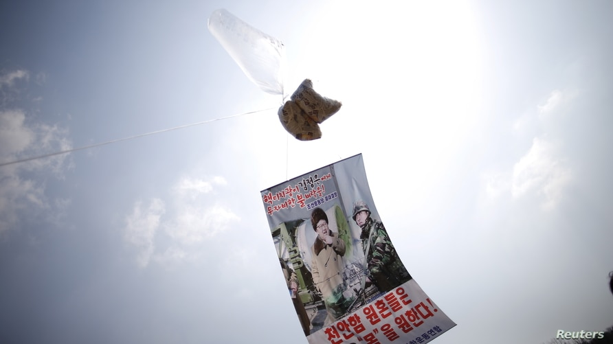A balloon containing leaflets denouncing North Korean leader Kim Jong Un is seen near the demilitarized zone separating the two…