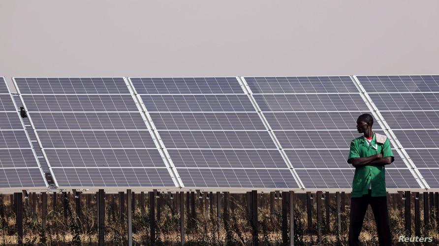 Solar panels are seen during the inauguration ceremony of the solar energy power plant in Zaktubi, near Ouagadougou, Burkina…