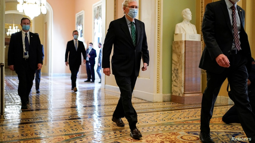 Senate Majority Leader Mitch McConnell (R-KY) walks to the Senate Chamber on Capitol Hill in Washington, U.S., September 30,…