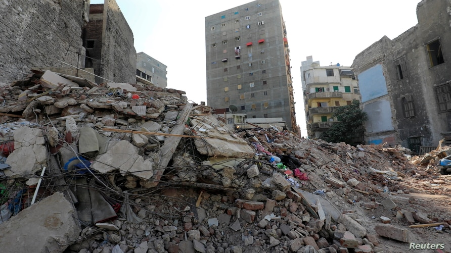 A view shows the site of a collapsed apartment building in Alexandria, Egypt, Dec. 3, 2020.