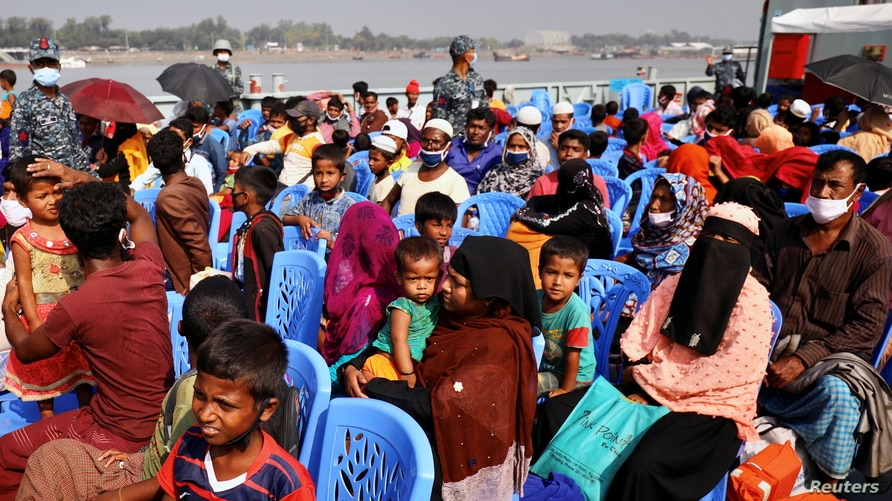 Rohingyas sit onboard a ship as they move to Bhasan Char island near Chattogram, Bangladesh, December 4, 2020. REUTERS/Mohammad…