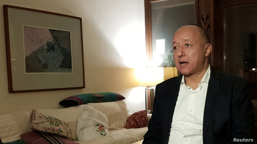 Gasser Abdel Razek, Executive Director of the Egyptian Initiative for Personal Rights (EIPR) speaks during an interview with Reuters in his home in Cairo, Egypt, Dec. 4, 2020.