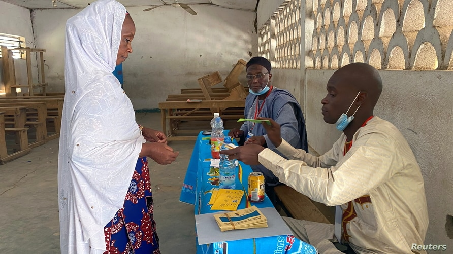 A voter arrives to cast her ballot during the first regional election in Maroua, Cameroon, Dec. 6, 2020.