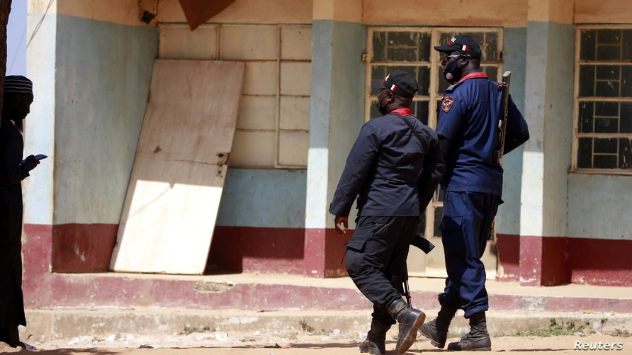 Police members are deployed after gunmen abducted students from the all-boys Government Science school in Kankara, in…