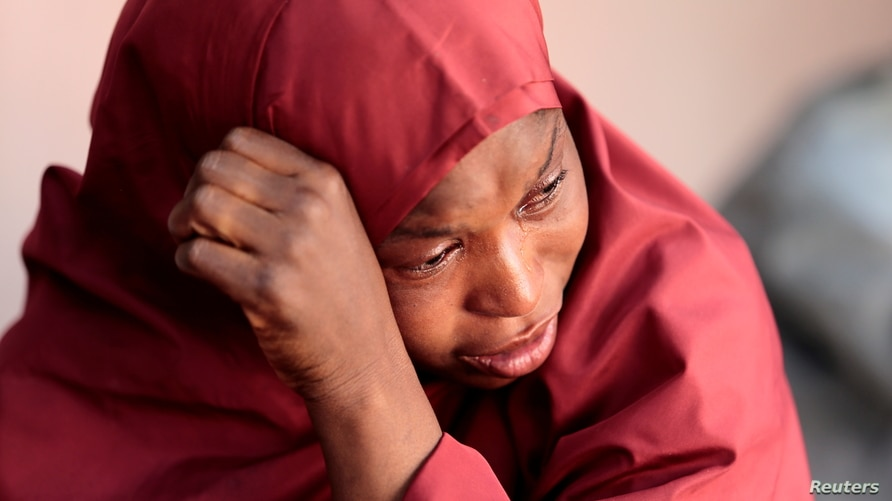 The mother of Muhammad Bello, one the students who was abducted by gunmen, reacts in Kankara, in northwestern Katsina state,…