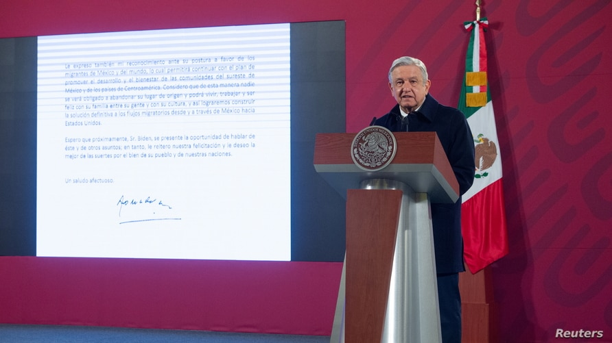 Mexico's President Andres Manuel Lopez Obrador speaks as a screen displays the letter he sent to U.S. President-elect Joe Biden…