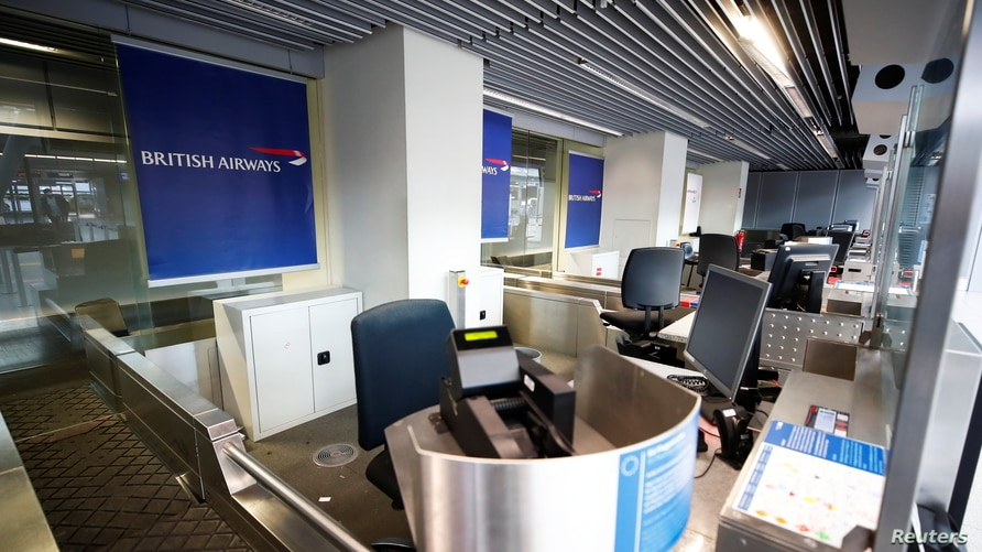 Empty British Airways' counters are pictured at Duesseldorf Airport, as EU countries impose a travel ban from the UK following…
