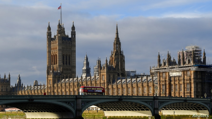 The British union flag flutters on the Victoria Tower at the Houses of Parliament, as Parliament is recalled to ratify…