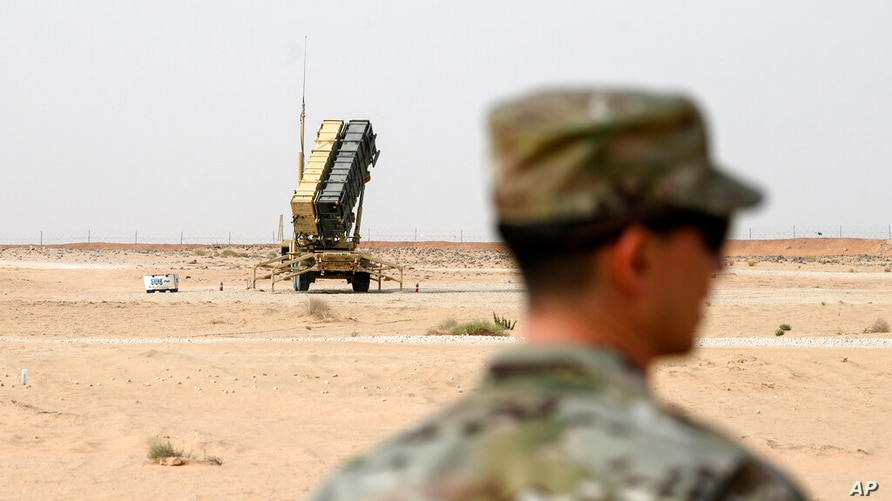 FILE - In this Feb. 20, 2020, file photo, a member of the U.S. Air Force stands near a Patriot missile battery at the Prince…