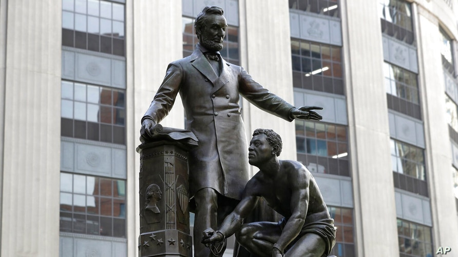 A statue that depicts a freed slave kneeling at Abraham Lincoln's feet rests on a pedestal, Thursday, June 25, 2020, in Boston…