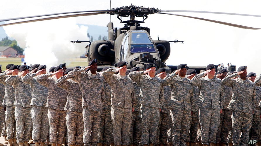 FILE - In this Friday, May 13, 2011 file photo, Soldiers of 1AD attend a color casing ceremony of the First Armored Division at…