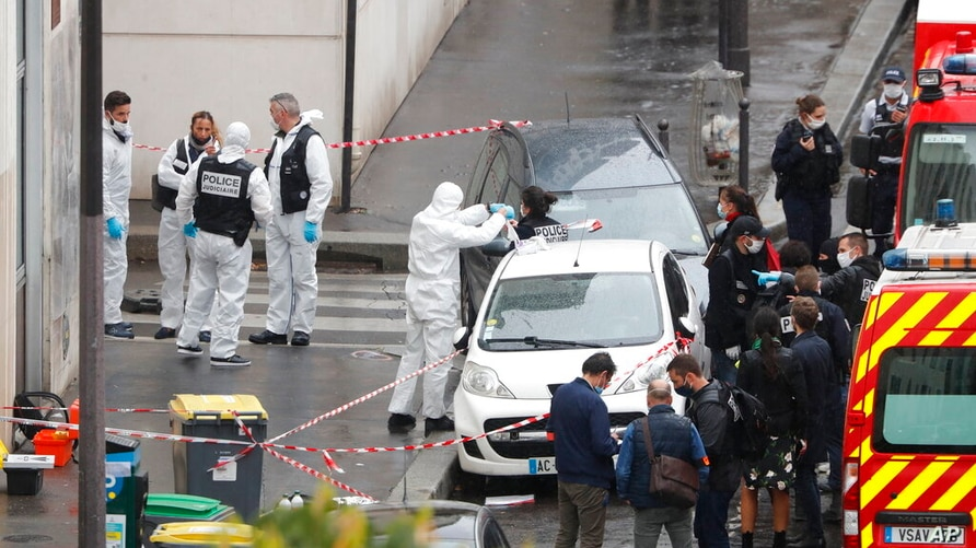 FILE - In this Sept. 25, 2020 file photo, police and forensic investigate an attack that wounded two people near the former…