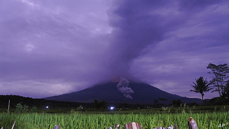 Volcanic materials spew from the crater of Mount Semeru in Lumajang, East Java, Indonesia, Tuesday, Dec. 1, 2020. Indonesian…