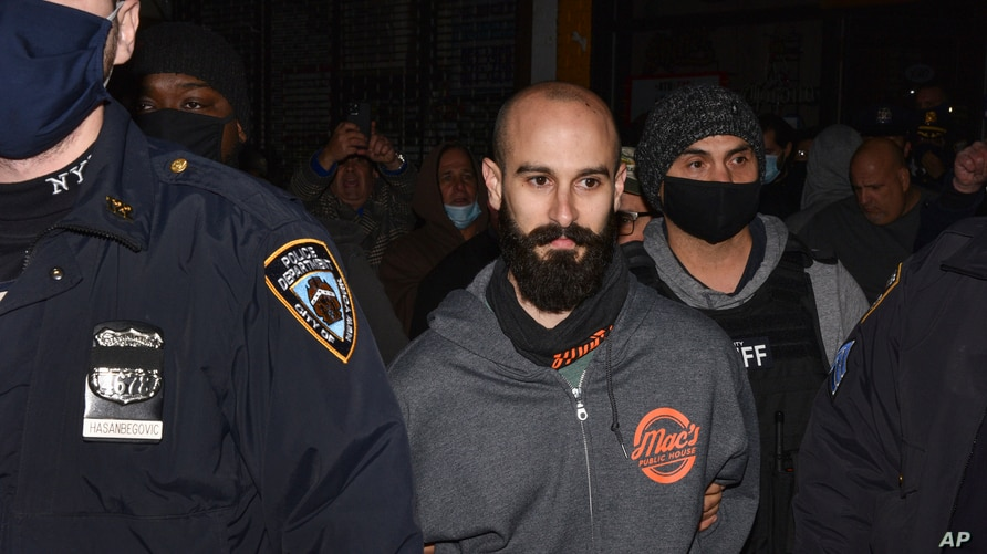 Mac's Public House co-owner Danny Presti is taken away in handcuffs after being arrested by New York City sheriff's deputies,…