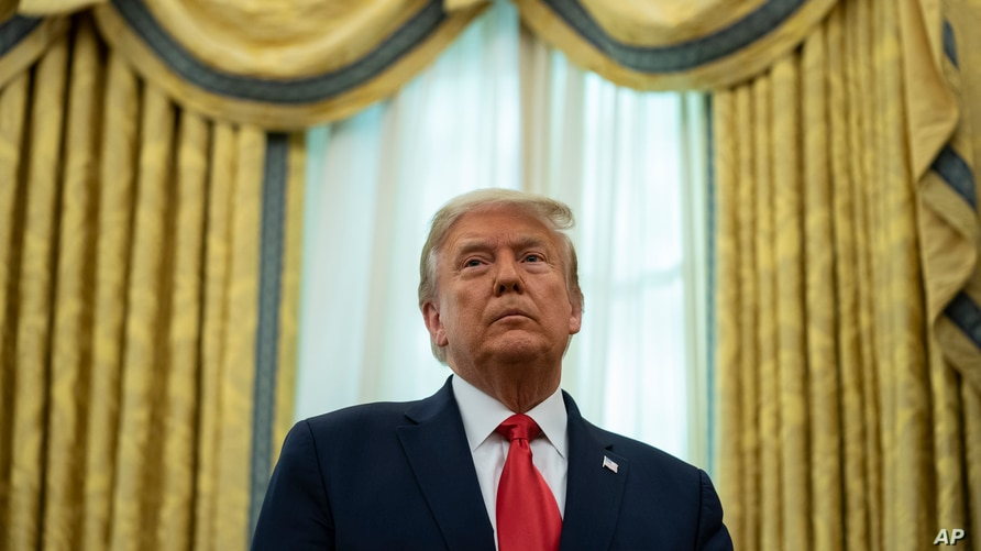 President Donald Trump presides over the Presidential Medal of Freedom ceremony at the White House, Dec. 3, 2020.