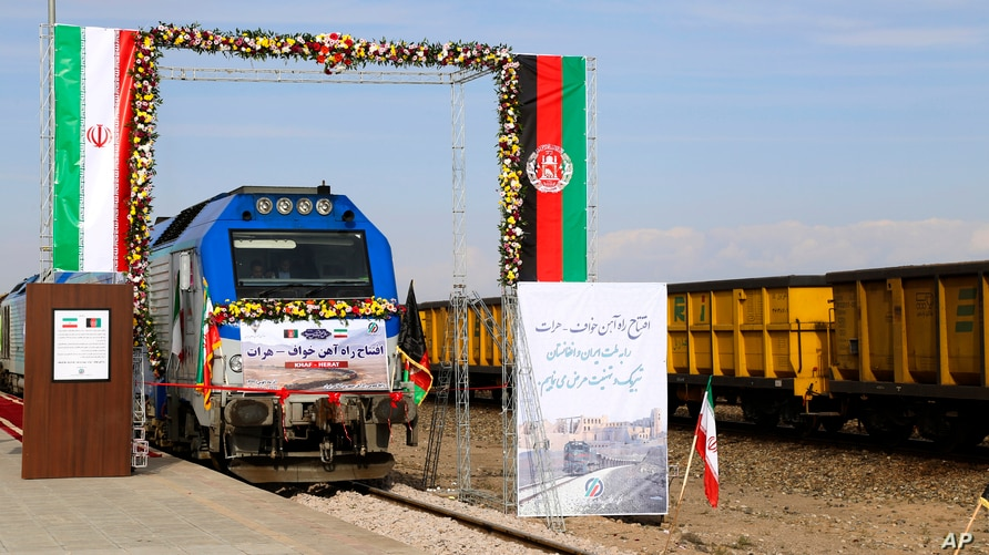 A train prepares to move during the inauguration of a 140-kilometer (90-mile) line running from eastern Iran into western Afghanistan, at a railroad station in Khaf, Iran, Dec. 10, 2020.