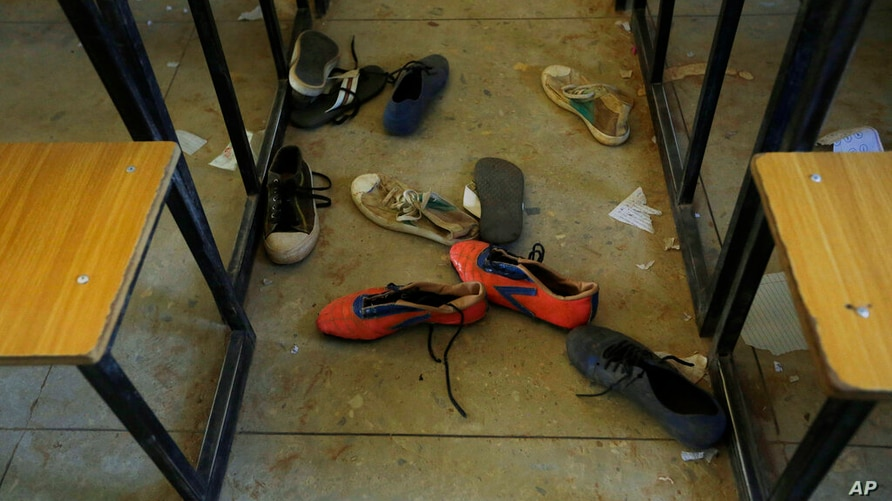 Shoes of the kidnapped students from Government Science Secondary School are seen inside their classroom Kankara, Nigeria,…