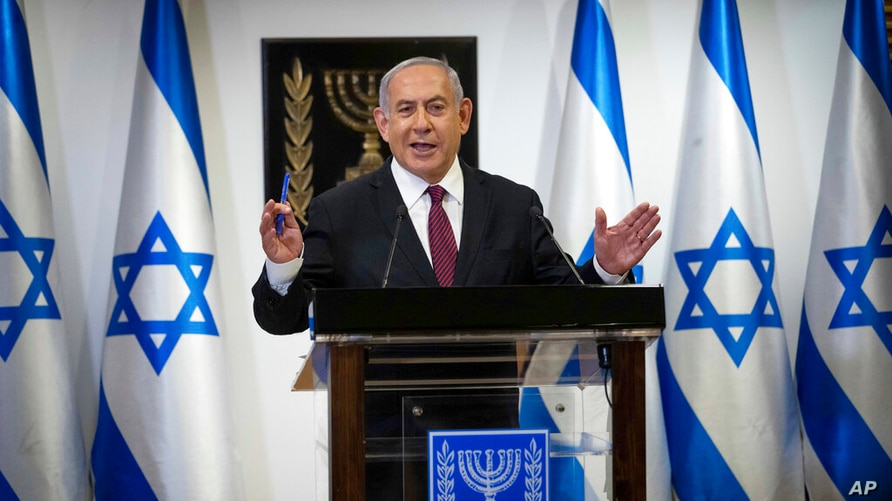 Israeli Prime Minister Benjamin Netanyahu delivers a statement at the Israeli Knesset, or Parliament, in Jerusalem, Tuesday,…