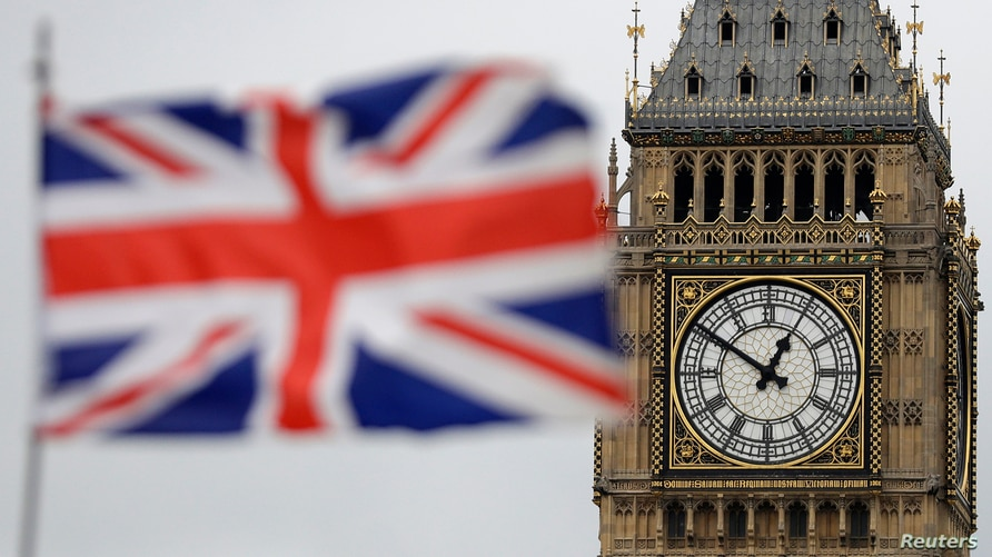 FILE - In this Wednesday, March 29, 2017 file photo British Union flag waves in front of the Elizabeth Tower at Houses of…