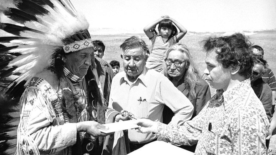 FILE - In this May 5, 1973 file photo Hank Adams, right, permanent representative of the Indians Trial of Broken Treaties…