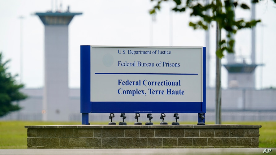 FILE - This Aug. 28, 2020, file photo shows the federal prison complex in Terre Haute, Ind.   (AP Photo/Michael Conroy, File)A…