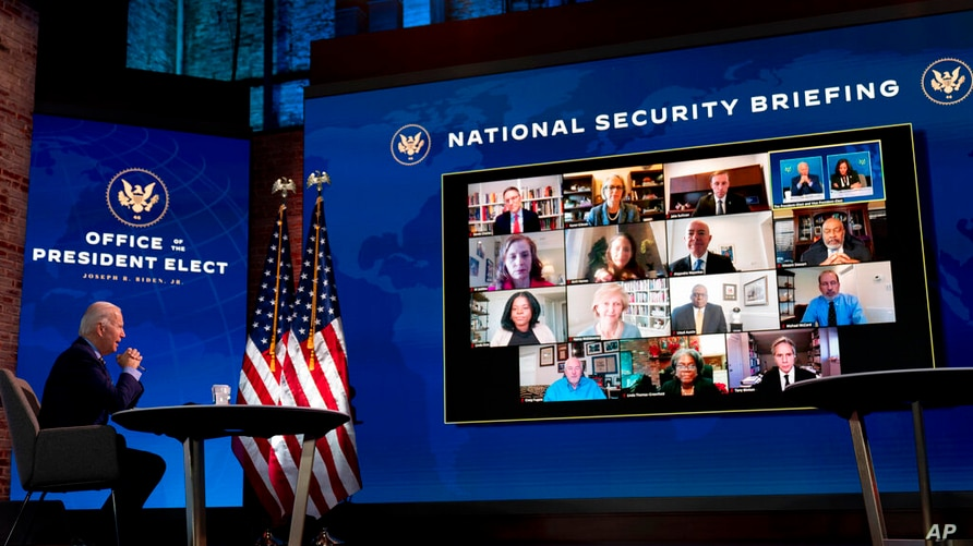 President-elect Joe Biden speaks during a virtual meeting with members of his national security and foreign policy agency…