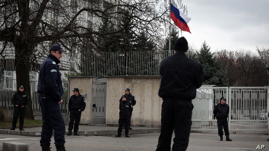 FILE - Bulgarian police officers stand guard in front of Russian embassy in Sofia, Bulgaria.