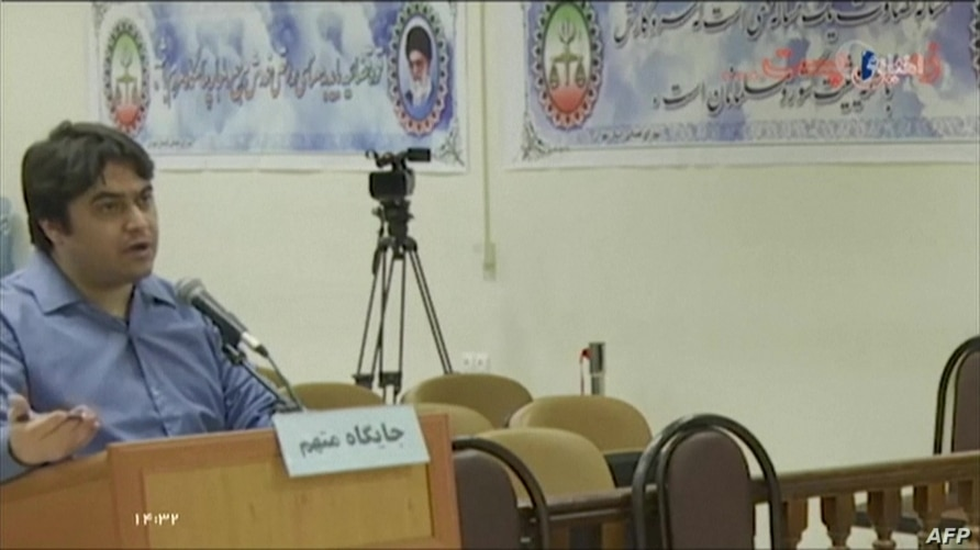 (FILES) An image grab from footage obtained from Iranian State TV IRIB shows Ruhollah Zam, a former opposition figure who had…