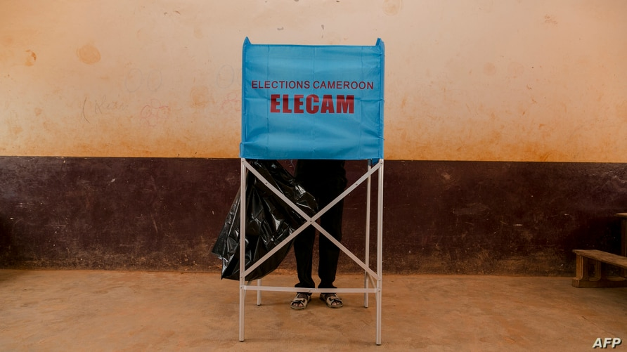 FILE - A man is seen at a voting booth during general and municipal elections in Yaounde, Cameroon, Feb. 9, 2020. The country held its first regional elections Sunday.