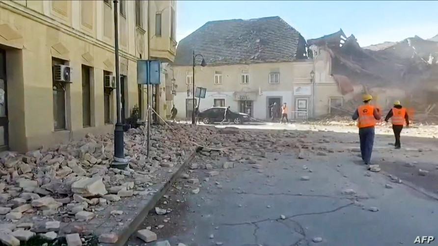 A video grab released by the Croatian Red Cross Dec. 29, 2020, shows rubble in the streets and rescue teams arriving in Petrinja, after the town was struck by an earthquake.