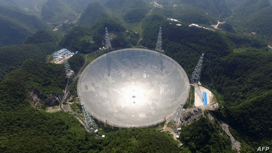 This handout photo taken Aug. 24, 2016 and released Dec. 13, 2020, by the National Astronomical Observatories of the Chinese Academy of Sciences (NAOC) shows the 500-meter Aperture Spherical Radio Telescope (FAST) in China's Guizhou province.