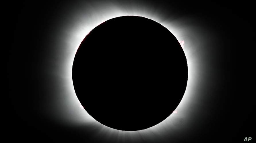 The moon covers the sun during a total solar eclipse in Piedra del Aguila, Argentina.