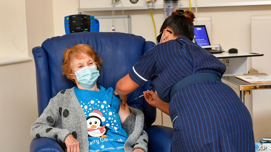 Margaret Keenan, 90, is the first patient in the UK to receive the Pfizer-BioNTech COVID-19 vaccine, at University Hospital, Coventry, England, Dec. 8, 2020.