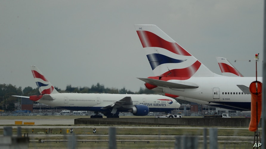FILE - British Airways planes are seen parked at Heathrow Airport in London, Sept. 9, 2019.