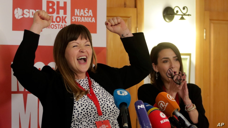 Irma Baralija greets supporters at her headquarters after local elections in Mostar, Bosnia, Sunday, Dec. 20, 2020.