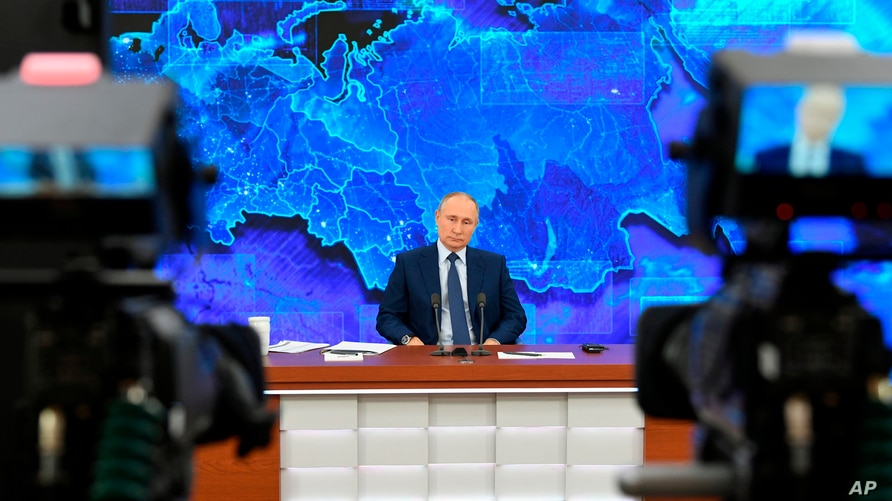 Russian President Vladimir Putin speaks via video connection during a news conference in Moscow, Russia, Dec. 17, 2020. This year, Putin held his annual news conference online due to the coronavirus pandemic.