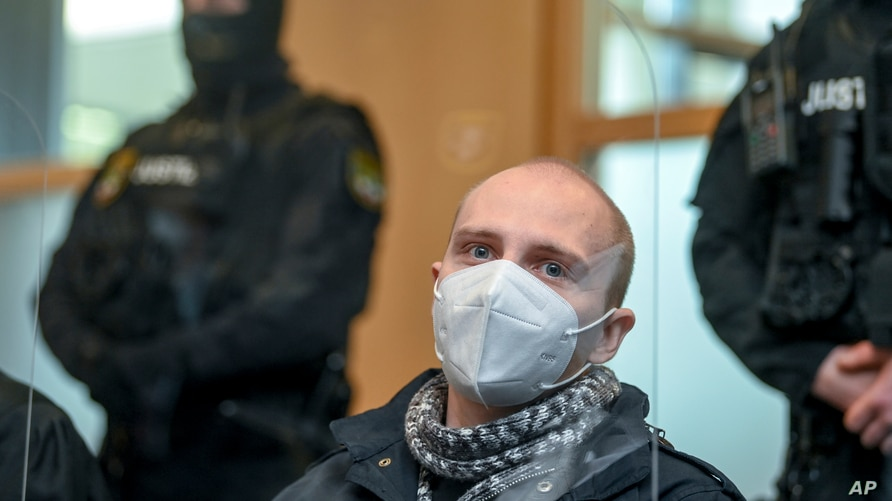 Defendant Stephan Balliet sits in a courtroom before the verdict at his trial, in Magdeburg, Germany, Dec. 21, 2020.