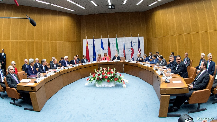 FILE - Participants of the Iran nuclear talks that culminated in the signing of the Joint Comprehensive Plan of Action (JCPOA), are pictured during a meeting at the United Nations building in Vienna, Austria, July 14, 2015.