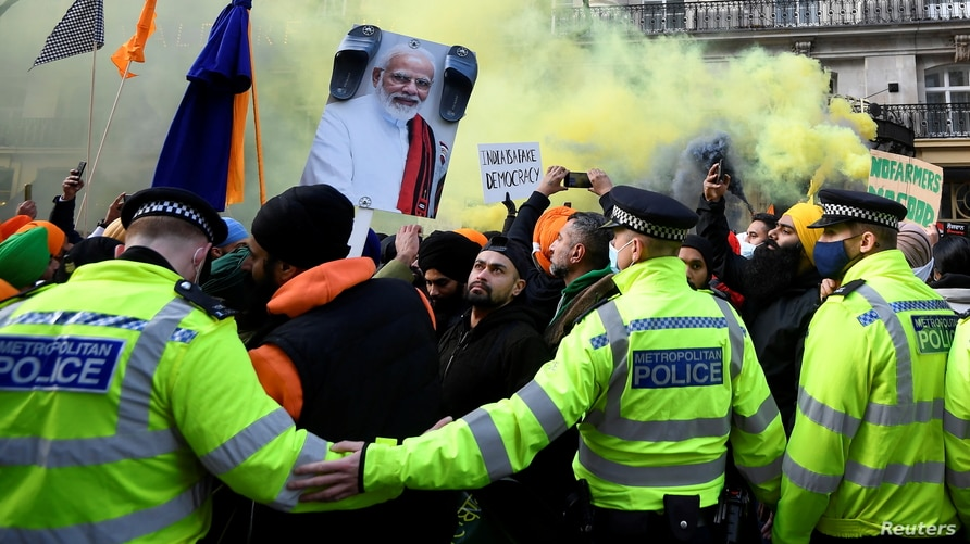 British Sikhs gather to protest against India's new farming legislation, outside the High Commission of India in London, Britain, Dec. 6, 2020.