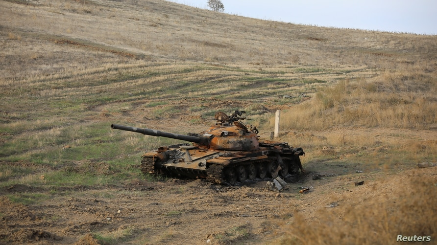 A view shows a burnt tank near Hadrut town, which recently came under the control of Azerbaijan's troops following a military conflict against ethnic Armenian forces, in the region of Nagorno-Karabakh, Nov. 25, 2020.