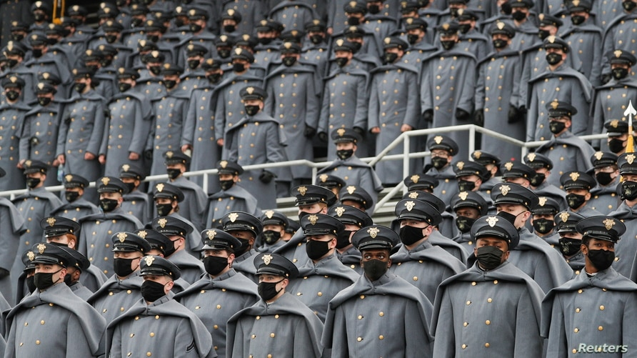 U.S. Army cadets wearing protective masks stand at Michie Stadium ahead of the annual Army-Navy collegiate football game, in West Point, New York, Dec. 12, 2020.