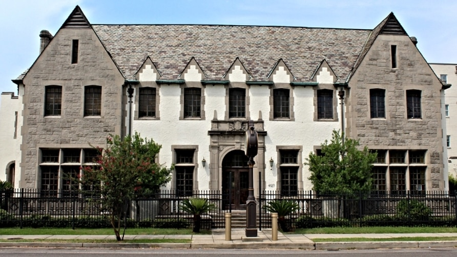 Tudor Square, a former funeral home built 1929, is now an apartment complex in New Orleans. (Courtesy RENTCafe)